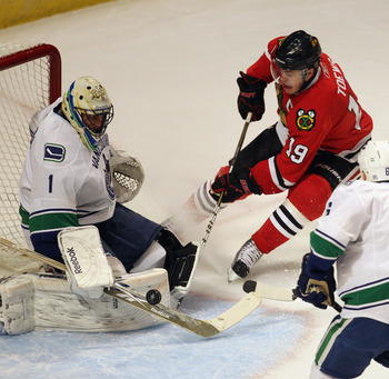 CHICAGO, IL - APRIL 17: Roberto Luongo #1 of the Vancouver Canucks stops a shot by Jonathan Toews #19 of the Chicago Blackhawks in Game Three of the Western Conference Quarterfinals during the 2011 NHL Stanley Cup Playoffs at the United Center on April 17