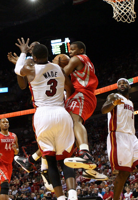 MIAMI, FL - MARCH 27:  Guard Dwyane Wade #3 of the Miami Heat defends against gurad Kyle Lowry #7 of the Houston Rockets  at American Airlines Arena on March 27, 2011 in Miami, Florida. NOTE TO USER: User expressly acknowledges and agrees that, by downloa
