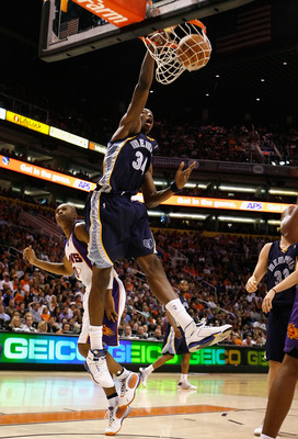 PHOENIX - NOVEMBER 25:  Hasheem Thabeet #34 of the Memphis Grizzlies slam dunks the ball over Leandro Barbosa #10 of the Phoenix Suns during the NBA game at US Airways Center on November 25, 2009 in Phoenix, Arizona. NOTE TO USER: User expressly acknowled