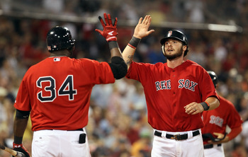 BOSTON, MA - JULY 22:  Jarrod Saltalamacchia #39 of the Boston Red Sox is congratulated by teammate David Ortiz #34 after he scored in the seventh inning against the Seattle Mariners on July 22, 2011 at Fenway Park in Boston, Massachusetts.  (Photo by Els