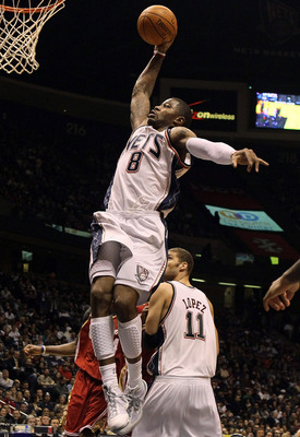 EAST RUTHERFORD, NJ - MARCH 03:  Terrence Williams #8 of the New Jersey Nets dunks against the Cleveland Cavaliers at the Izod Center on March 3, 2010 in East Rutherford, New Jersey.NOTE TO USER: User expressly acknowledges and agrees that, by downloading