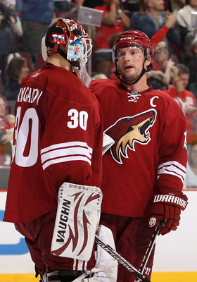 GLENDALE, AZ - APRIL 20:  Shane Doan #19 of the Phoenix Coyotes talks with goaltender Ilya Bryzgalov #30 after being defeated by the Detroit Red Wings in Game Four of the Western Conference Quarterfinals during the 2011 NHL Stanley Cup Playoffs at Jobing.