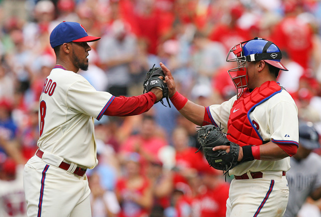 PHILADELPHIA - JULY 24: Relief pitcher Antonio Bastardo #58 of the Philadelphia Phillies is congratulated by catcher Carlos Ruiz #51 after his save during a game against the San Diego Padres at Citizens Bank Park on July 24, 2011 in Philadelphia, Pennsylv
