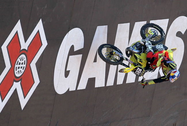 LOS ANGELES - JULY 29: Travis Pastrana #199 climbs up a wall during the Moto X Freestyle Round One at the Los Angeles Coliseum during X Games 16 on July 29, 2010 in Los Angeles, California. (Photo be Stephen Dunn/Getty Images)