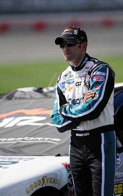LEBANON, TN - JULY 23:  Aric Almirola, driver of the #88 Degree MEN Chevrolet, stands on pit road during qualifying for the NASCAR Nationwide Series Federated Auto Parts 300 at Nashville Superspeedway on July 23, 2011 in Lebanon, Tennessee.  (Photo by Jar