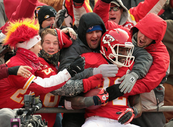 KANSAS CITY, MO - DECEMBER 26:  Receiver Dwayne Bowe #82 of the Kansas City Chiefs is congratulated by fans as he jumps into the stands after making a 75 yard touchdown catch during the game against the Tennessee Titans on December 26, 2010 at Arrowhead S