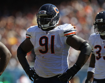 CHICAGO - SEPTEMBER 12: Tommie Harris #91 of the Chicago Bears awaits the start of play against the Detroit Lions during the NFL season opening game at Soldier Field on September 12, 2010 in Chicago, Illinois. The Bears defeated the Lions 19-14. (Photo by