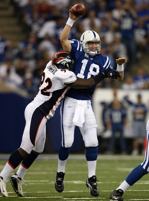 INDIANAPOLIS - SEPTEMBER 30:  Peyton Manning #18 of the Indianapolis Colts is hit by Elvis Dumervil #92 of the Denver Broncos as he throws a pass during the NFL game on September 30, 2007 at the RCA Dome in Indianapolis, Indiana.  (Photo by Andy Lyons/Get