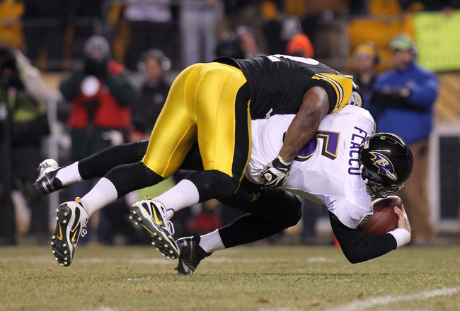 PITTSBURGH, PA - JANUARY 15:  Linebacker James Harrison #92 of the Pittsburgh Steelers sacks quarterback Joe Flacco #5 of the Baltimore Ravens during the AFC Divisional Playoff Game at Heinz Field on January 15, 2011 in Pittsburgh, Pennsylvania.  (Photo b