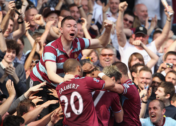 LONDON, ENGLAND - APRIL 24:  A supporter celebrates with Radoslav Kovac of West Ham and his teammates after he scores during the Barclays Premier League match between West Ham United and Wigan Athletic at the Boleyn Ground on April 24, 2010 in London, Eng