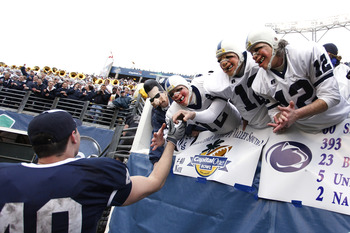 ORLANDO, FL - JANUARY 1: Andrew Pitz #40 of the Penn State Nittany Lions celebrates with fans following the 2010 Capital One Bowl against the LSU Tigers at the Florida Citrus Bowl Stadium on January 1, 2010 in Orlando, Florida. Penn State won 19-17. (Phot