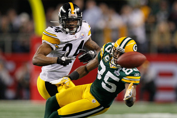 ARLINGTON, TX - FEBRUARY 06: Greg Jennings #85 of the Green Bay Packers goes for a catch against Ike Taylor #24 of the Pittsburgh Steelers during Super Bowl XLV at Cowboys Stadium on February 6, 2011 in Arlington, Texas.  (Photo by Kevin C. Cox/Getty Imag