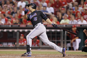 CINCINNATI, OH - JULY 25: Carlos Beltran #15 of the New York Mets drives in the game-tying run in the seventh inning with a sacrifice fly against the Cincinnati Reds at Great American Ball Park on July 25, 2011 in Cincinnati, Ohio. (Photo by Joe Robbins/G