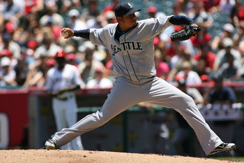 ANAHEIM, CA - JULY 10:  Felix Hernandez #34 of the Seattle Mariners pitches against the Los Angeles Angels of Anaheim in the first inning of the game at Angel Stadium of Anaheim on July 10, 2011 in Anaheim, California  (Photo by Jeff Golden/Getty Images)