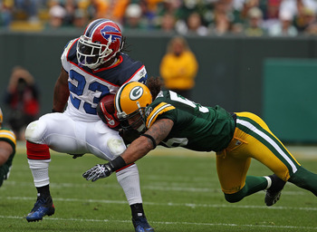 GREEN BAY, WI - SEPTEMBER 19: Nick Barnett #56 of the Green Bay Packers tackles Marshawn Lynch #23 of the Buffalo Bills at Lambeau Field on September 19, 2010 in Green Bay, Wisconsin. The Packers defeated the Bills 34-7. (Photo by Jonathan Daniel/Getty Im