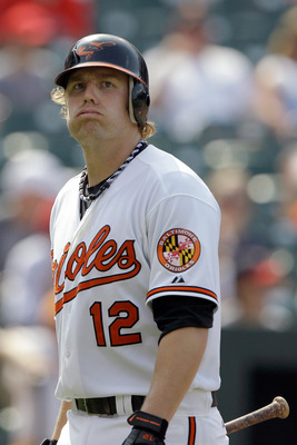 BALTIMORE, MD - JULY 24: Mark Reynolds #12 of the Baltimore Orioles walks back to the dugout after striking out against the Los Angeles Angels of Anaheim during the ninth inning at Oriole Park at Camden Yards on July 24, 2011 in Baltimore, Maryland.  The