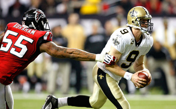 ATLANTA - DECEMBER 13:  John Abraham #55 of the Atlanta Falcons pressures quarterback Drew Brees #9 of the New Orleans Saints at Georgia Dome on December 13, 2009 in Atlanta, Georgia.  (Photo by Kevin C. Cox/Getty Images)