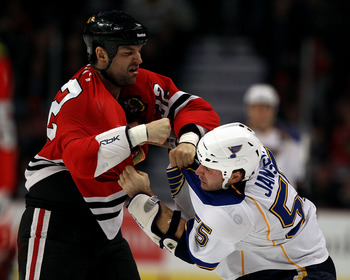 CHICAGO - NOVEMBER 30:John Scott #32 of the Chicago Blackhawks fights with Cam Janssen #55 of the St. Louis Blues at the United Center on November 30, 2010 in Chicago, Illinois. (Photo by Jonathan Daniel/Getty Images)