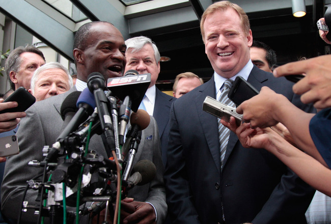 WASHINGTON, DC - JULY 25:  DeMaurice Smith (L)  executive director of the National Football League Players' Association and NFL commissioner Roger Goodell (R) address the the media on July 25, 2011 in Washington, DC.  The NFL players and owners announced
