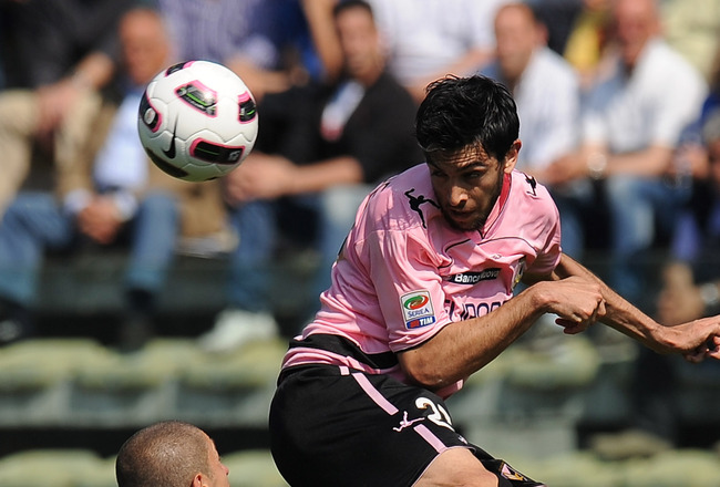 PARMA, ITALY - MAY 01:  Javier Pastore (R) of Palermo jumps for the ball as Stefano Morrone of Parma looks on during the Serie A match between Parma FC and US Citta di Palermo at Stadio Ennio Tardini on May 1, 2011 in Parma, Italy.  (Photo by Tullio M. Pu