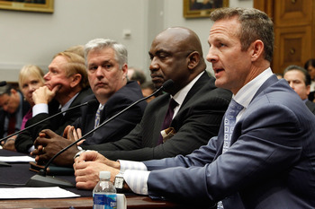 WASHINGTON - OCTOBER 28:  Retired National Football League player Merril Hoge (R) testifies before the House Judiciary Committee about football brain injuries on Captiol Hill October 28, 2009 in Washington, DC. A recent NFL study of retired players sugges
