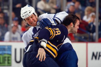 BUFFALO, NY - MARCH 27:  Pavel Kubina #77 of the Toronto Maple Leafs fights against Paul Gaustad #28 of the Buffalo Sabres on March 27, 2009 at HSBC Arena in Buffalo, New York. (Photo by Rick Stewart/Getty Images)