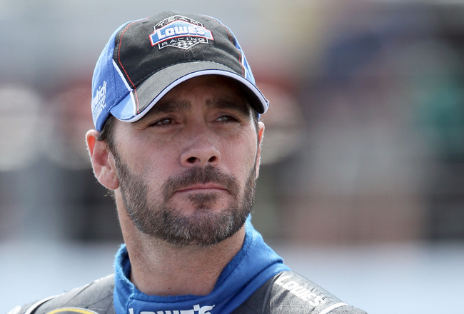 LOUDON, NH - JULY 15:  Jimmie Johnson, driver of the #48 Lowe's Chevrolet, stands by his car during qualifying for the NASCAR Sprint Cup Series LENOX Industrial Tools 301 at New Hampshire Motor Speedway on July 15, 2011 in Loudon, New Hampshire.  (Photo b
