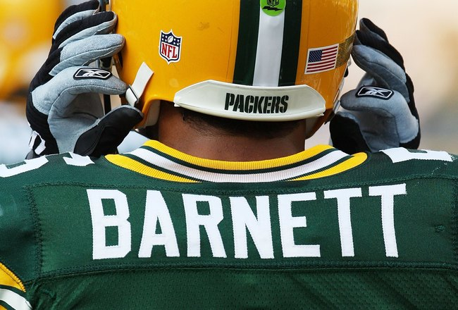 GREEN BAY, WI - AUGUST 28: A green NFL communication sticker is seen on the helmut of Nick Barnett #56 of the Green Bay Packers before a game against the Tenessee Titans on August 28, 2008 at Lambeau Field in Green Bay, Wisconsin. (Photo by Jonathan Danie