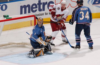 ATLANTA - JANUARY 5:  Johan Hedberg #1 of the Atlanta Thrashers tends goal against Steven Reinprecht #28 of the Phoenix Coyotes on January 5, 2007 at Philips Arena in Atlanta, Georgia. The Coyotes won 5-4 in overtime. (Photo by Scott Cunningham/Getty Imag