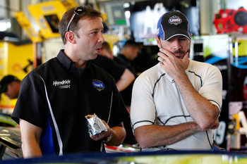 SPARTA, KY - JULY 07: Crew chief Chad Knaus (L) talks with Jimmie Johnson (R), driver of the #48 Lowe's Chevrolet, in the garage prior to testing for the NASCAR Sprint Cup Series at Kentucky Speedway on July 7, 2011 in Sparta, Kentucky.  (Photo by Geoff B