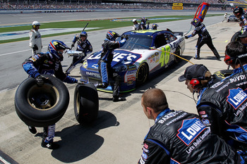 TALLADEGA, AL - APRIL 17:  Jimmie Johnson, driver of the #48 Lowe's Chevrolet, comes in for a pit stop during the NASCAR Sprint Cup Series Aaron's 499 at Talladega Superspeedway on April 17, 2011 in Talladega, Alabama.  (Photo by Todd Warshaw/Getty Images
