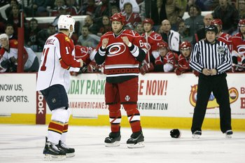 RALEIGH, NC - DECEMBER 18:  Tim Gleason #6 of the Carolina Hurricanes looks to fight Gregory Campbell #11 of the Florida Panthers on December 18, 2008 at RBC Center in Raleigh, North Carolina.  (Photo by Kevin C. Cox/Getty Images)