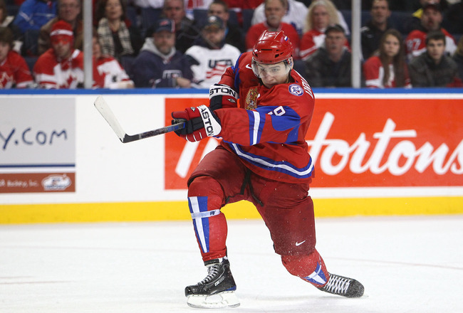 BUFFALO, NY - DECEMBER 26:  Dmitri Orlov #9 of Russia fires the puck during the 2011 IIHF World U20 Championship Group B game between Canada and Russia on December 26, 2010 at HSBC Arena in Buffalo, New York. (Photo by Tom Szczerbowski/Getty Images)