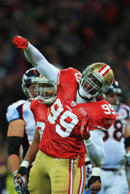 LONDON, ENGLAND - OCTOBER 31:  Manny Lawson #99 of San Francisco 49ers celebrates as he sacks Kyle Orton #8 of Denver Broncos during the NFL International Series match between Denver Broncos and San Francisco 49ers at Wembley Stadium on October 31, 2010 i
