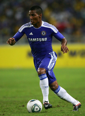 KUALA LUMPUR, MALAYSIA - JULY 21: Florent Malouda of Chelsea in action during the pre-season friendly match between Malaysia and Chelsea at Bukit Jalil National Stadium on July 21, 2011 in Kuala Lumpur, Malaysia.  (Photo by Stanley Chou/Getty Images)