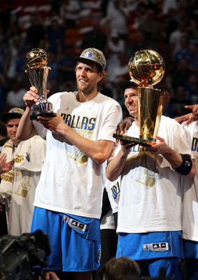 MIAMI, FL - JUNE 12:  (L-R)  Finals MVP Dirk Nowitzki #41 and Jason Kidd #2 of the Dallas Mavericks celebrate with the Larry O'Brien Championship trophy after the Mavericks won 105-95 against the Miami Heat in Game Six of the 2011 NBA Finals at American A