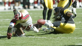 PITTSBURGH - SEPTEMBER 23:  Vernon Davis #85 of the San Francisco 49ers loses control of the ball after being hit by Troy Polamalu #43 of the Pittsburgh Steelers on September 23, 2007 at Heinz Field in Pittsburgh, Pennsylvania. Pittsburgh won 36-17. (Phot