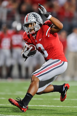 COLUMBUS, OH - NOVEMBER 13:  Brandon Saine #3 of the Ohio State Buckeyes runs with the ball against the Penn State Nittany Lions at Ohio Stadium on November 13, 2010 in Columbus, Ohio.  (Photo by Jamie Sabau/Getty Images)
