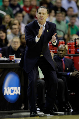 WASHINGTON - MARCH 17:  Head coach of the Pittsburgh Panthers Jamie Dixon, shouts from the bench during their game against the North Carolina-Asheville Bulldogs during the second round of the 2011 NCAA men's basketball tournament at the Verizon Center on
