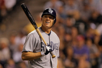 DENVER, CO - JUNE 14:  Nick Hundley #4 of the San Diego Padres looks at the scoreboard as he walks to the dugout after striking out in the eighth inning against the Colorado Rockies at Coors Field on June 14, 2011 in Denver, Colorado. The Rockies defeated
