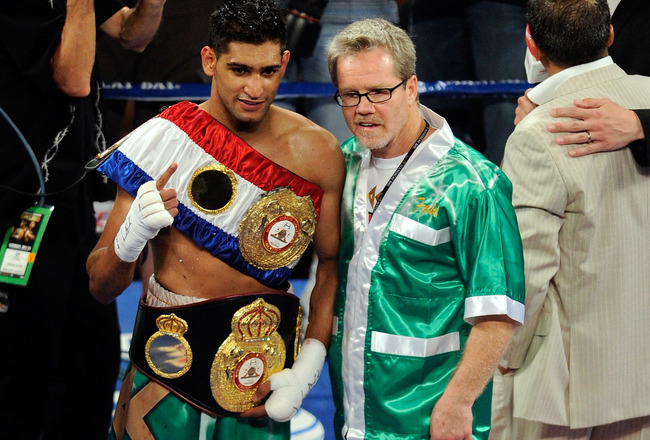LAS VEGAS, NV - JULY 23:  Amir Khan and trainer Freddie Roach pose after Khan's fifth round knockout of Zab Judah in their super lightweight world championship unification bout at Mandalay Bay Events Center on July 23, 2011 in Las Vegas, Nevada.  (Photo b
