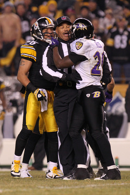 "Ravens' Ed Reed saying ""Hello"" to the Steelers' Hines Ward."