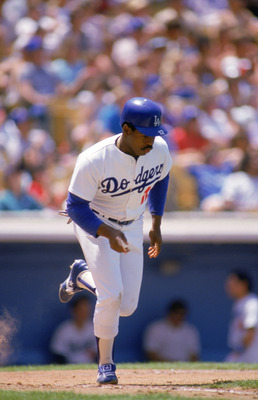 LOS ANGELES - 1986:  Bill Madlock #12 of the Los Angeles Dodgers runs out of the batters box during a game against the Philadelphia Phllies circa May of 1986 at Dodger Stadium in Los Angeles, California.  (Photo by Mike Powell/Getty Images)