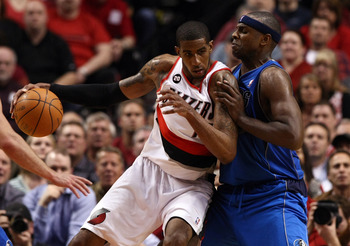 PORTLAND, OR - APRIL 21:  LaMarcus Aldridge #12 of the Portland Trail Blazers drives against Brendan Haywood #33 of the Dallas Mavericks in Game Three of the Western Conference Quarterfinals in the 2011 NBA Playoffs on April 21, 2011 at the Rose Garden in