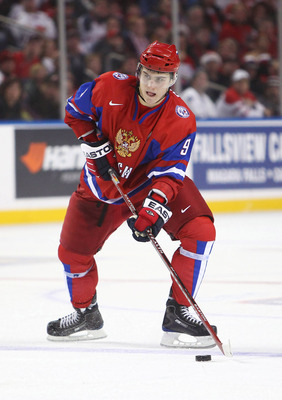 BUFFALO, NY - DECEMBER 26:  Dmitri Orlov #9 of Russia controls the puck during the 2011 IIHF World U20 Championship Group B game between Canada and Russia on December 26, 2010 at HSBC Arena in Buffalo, New York. (Photo by Tom Szczerbowski/Getty Images)