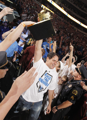 DALLAS, TX - JUNE 16: Dallas Mavericks owner Mark Cuban carries the Larry O'Brien Trophy to the stage during the Dallas Mavericks Victory celebration on June 16, 2011 in Dallas, Texas. (Photo by Brandon Wade/Getty Images)