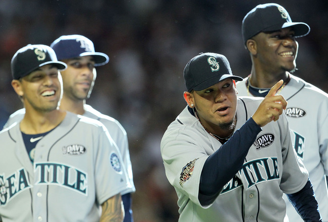 PHOENIX, AZ - JULY 12:  (2nd from R) American League All-Star Felix Hernandez #34 of the Seattle Mariners, reacts during player introductions before the start of the 82nd MLB All-Star Game at Chase Field on July 12, 2011 in Phoenix, Arizona.  (Photo by Je
