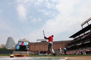 BALTIMORE, MD - JULY 24: Torii Hunter #48 of the Los Angeles Angels of Anaheim waits to bat against the Baltimore Orioles during the first inning at Oriole Park at Camden Yards on July 24, 2011 in Baltimore, Maryland.  The Angels defeated the Orioles 9-3.