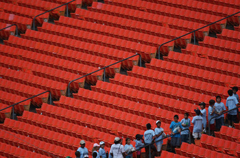 MIAMI GARDENS, FL - JULY 21: Fans exit the stands for safety during the rain delay during a game between the Florida Marlinsand the San Diego Padres at Sun Life Stadium on July 21, 2011 in Miami Gardens, Florida.  (Photo by Sarah Glenn/Getty Images)
