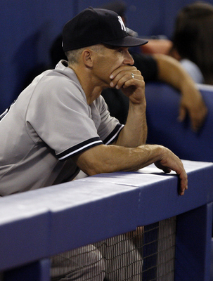 TORONTO, CANADA - JULY 15: Manager Joe Girardi looks out from the dugout after 7-1 loss against the Toronto Blue Jays during MLB action at The Rogers Centre July 15, 2011 in Toronto, Ontario, Canada. (Photo by Abelimages/Getty Images)